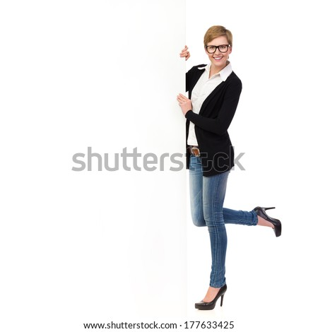 Blond woman in glasses standing on one leg and holding a banner. Full length studio shot isolated on white.