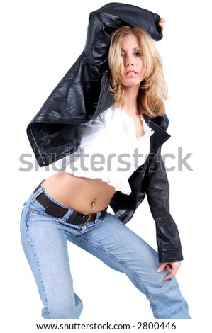 blond woman in leather jacket in dancing pose - stock photo