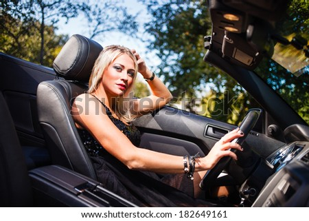 Blond woman in modern cabriolet. - stock photo