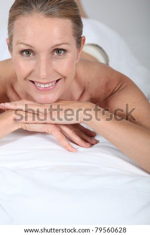 Blond woman laid on front awaiting massage - stock photo