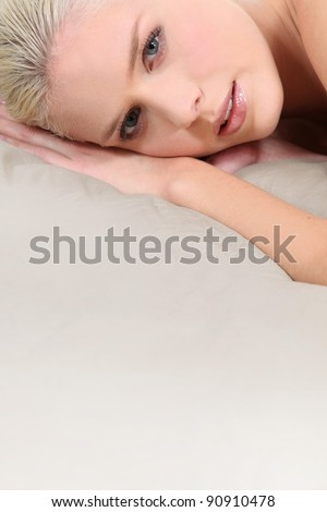 Blond woman laid on mattress