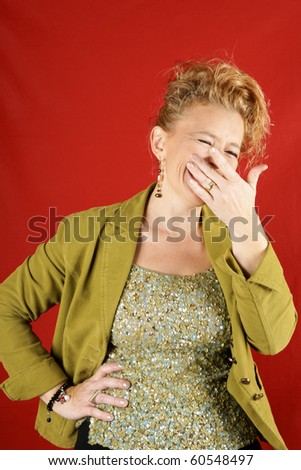Blond woman laughing, over a red background. With copy space.