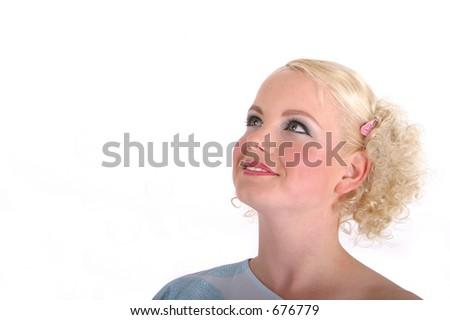 blond woman looking up. high key studio shot - stock photo