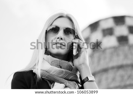 Blond woman on the phone - stock photo