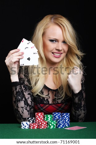 Blond woman playing poker