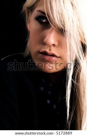 blond woman portrait in dark