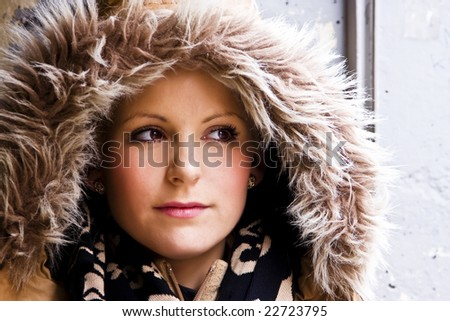 Blond woman portrait wearing a fur cap. - stock photo