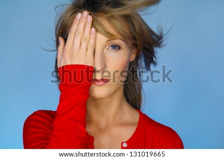 blond woman portrait with red blouse - stock photo