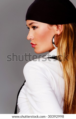 blond woman profile in white shirt and black head scarf - stock photo
