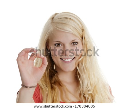 blond woman shows o.k. - stock photo