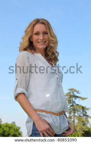 Blond woman smiling. - stock photo