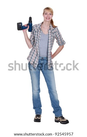 Blond woman stood with power drill - stock photo