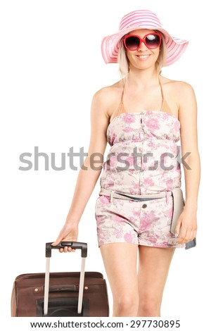 Blond woman walking with her luggage isolated on white background - stock photo