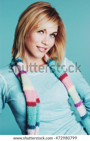Blond woman wearing winter scarf