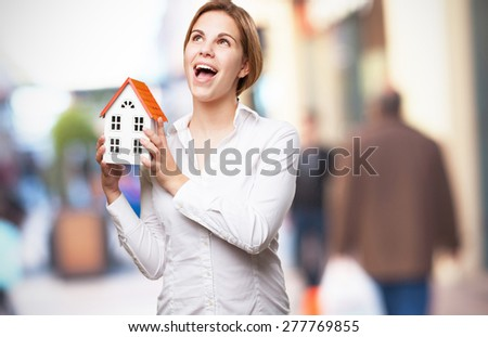 blond woman with a small house