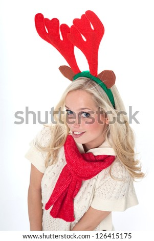 blond woman with antlers with an advertising space/young blond woman disguised as an elk/young blond woman with horns