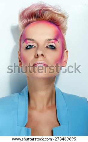 Blond woman with face art on white background