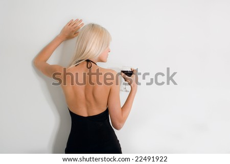 blond woman with glass of wine - stock photo