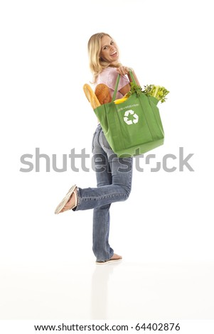 Blond woman with green grocery bag filled with healthy food