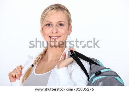 Blond woman with gym bag - stock photo