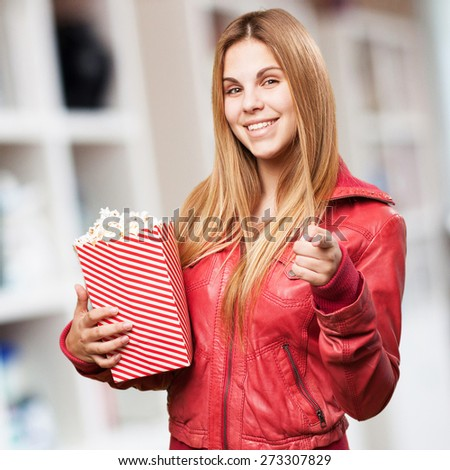 blond woman with pop corns