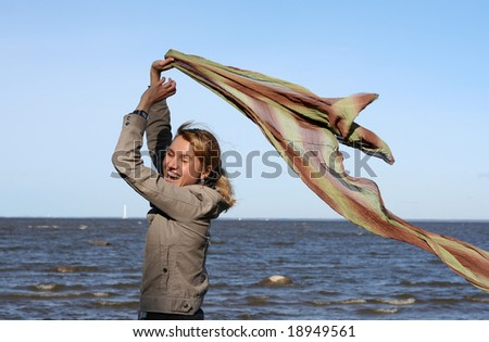 blond woman with scarf. Windy day. - stock photo