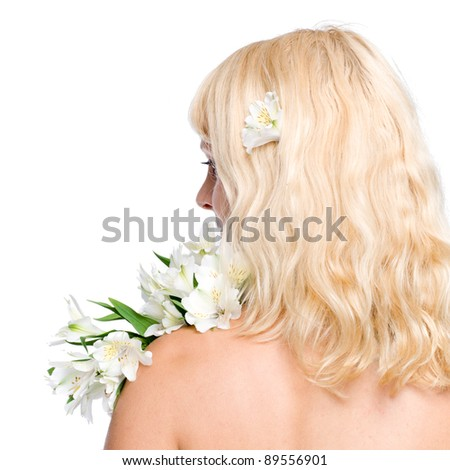 Blond woman with white flower, stands back, isolated over white