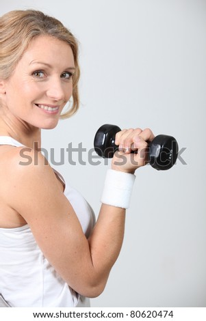 Blond women lifting weights