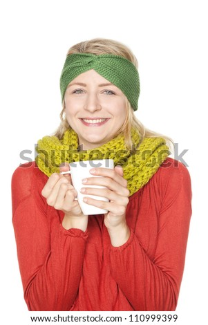 blond young woman drinking hot chocolate winter - stock photo