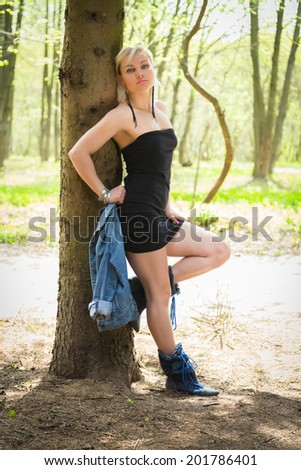 Blond young woman in the forest
