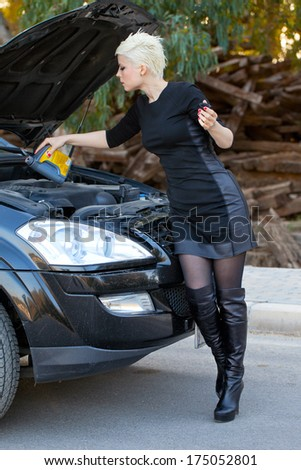 Blond Young Woman near the Car - stock photo