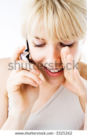 blond young woman with cell phone - stock photo