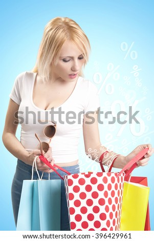 Blonde attractive shopper woman with the bags.Discounts and sales concept - stock photo