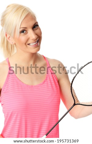 Blonde attractive woman wearing a pink top holding a badminton racket. White background. - stock photo