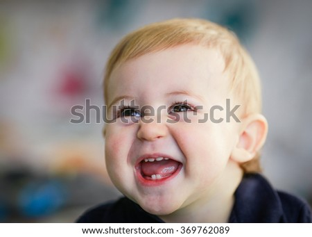 blonde baby portrait - laughing baby - stock photo