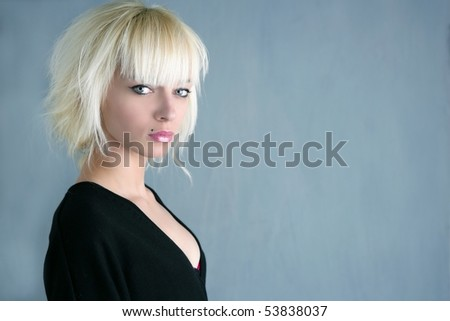 blonde beautiful fashion girl gray background - stock photo