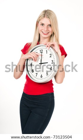 Blonde beautiful girl with big clock isolated on white. Time management