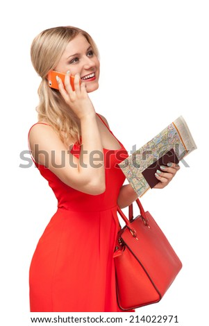 blonde beautiful woman in red dress holding big bag and documents  talking on the cell phone isolated on white - stock photo