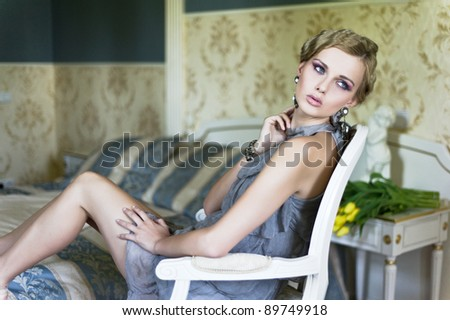 blonde beauty in a vintage room - stock photo