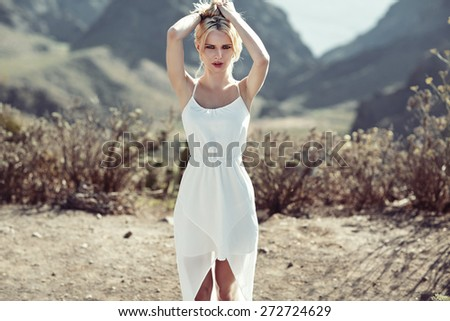 Blonde beauty on summer vacation day - stock photo
