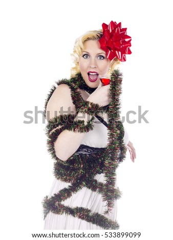 Blonde beauty retro woman having fun at a holiday christmas or new years party.  Shot in the studio and isolated on white background