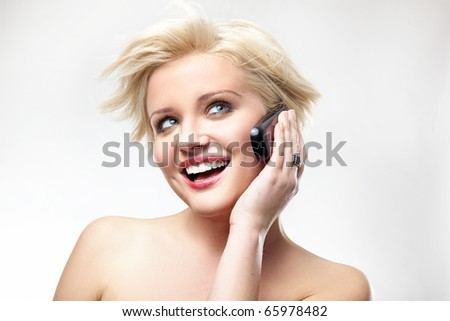 Blonde beauty speaking the phone - stock photo
