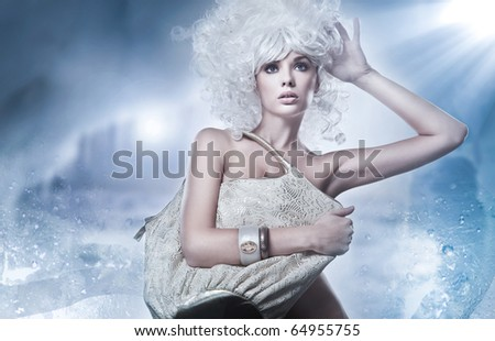 Blonde beauty with bag - stock photo
