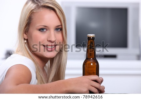 blonde bombshell with bottle of beer - stock photo