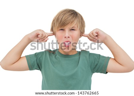 Blonde boy blocking his ears with fingers on white background