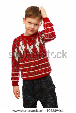 Blonde boy in a red sweater scratching his head thinking isolated on white background - stock photo