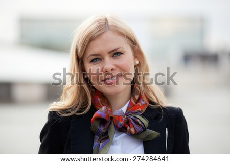 Blonde business woman smiling - stock photo