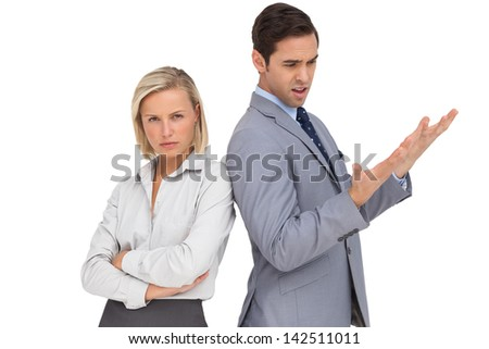 Blonde businesswoman angry against her colleague arguing on white background - stock photo