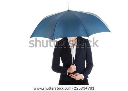 Blonde businesswoman holding an umbrella - stock photo
