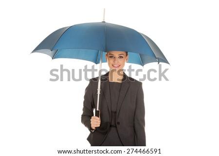 Blonde businesswoman holding an umbrella. - stock photo